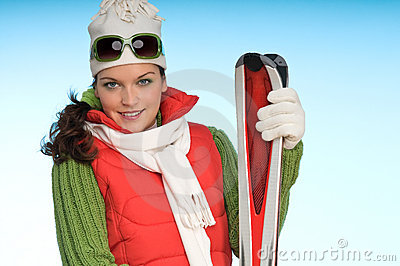 Sexy woman in winter outfit with skis