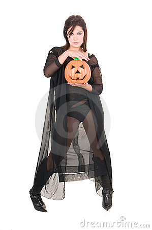 Sexy woman witch with halloween pumpkin