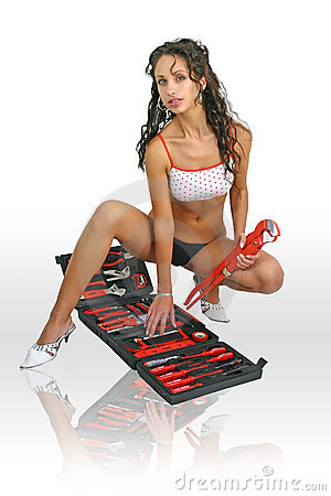 Sexy woman worker with spanner