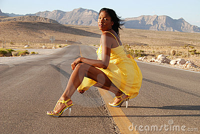 Sexy woman in yellow dress.