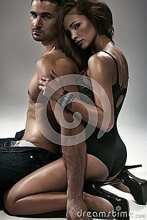 Sexy woman hugging her husband
