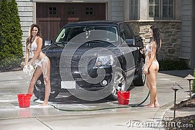 Sexy girls wash a black truck in bikinis