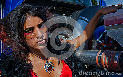 Sexy working girl adding coolant