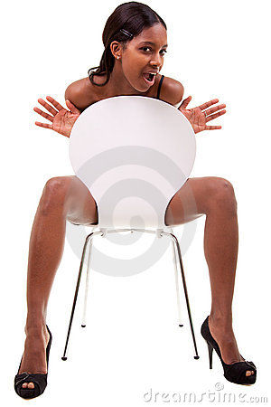 Sexy young black woman posing in chair