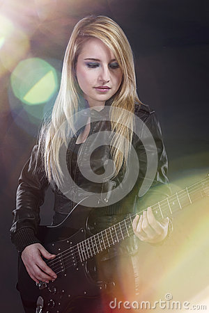Free Sexy Young Blonde Dressed In Black Leather Playing  Electric Gui Stock Photos - 30189983