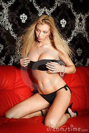 Sexy young blonde lady in black lingerie