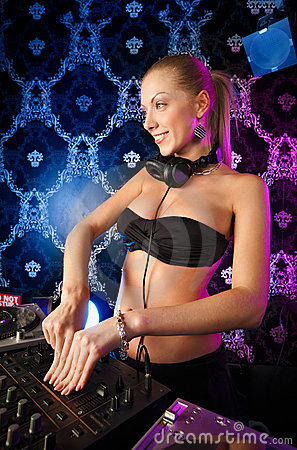 Sexy young blonde lady DJ playing music