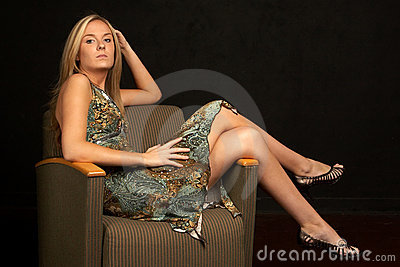 Sexy Young Blonde with Legs Over Chair