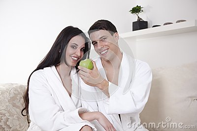 Sexy young couple in the morning with an apple