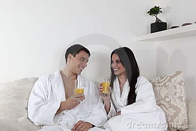 Sexy young couple in the morning having breakfast