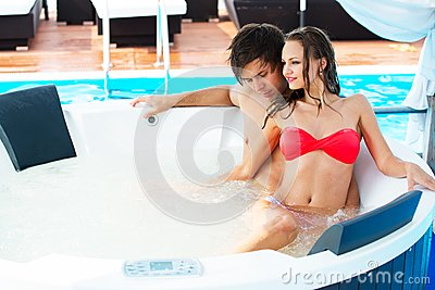 Sexy young couple on resort