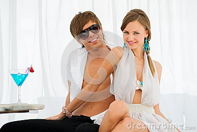 Sexy young couple on a resort