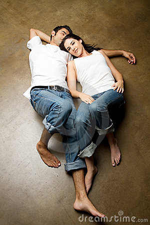 Free Sexy Young Ethnic Couple Relaxing On The Floor Royalty Free Stock Images - 15091469