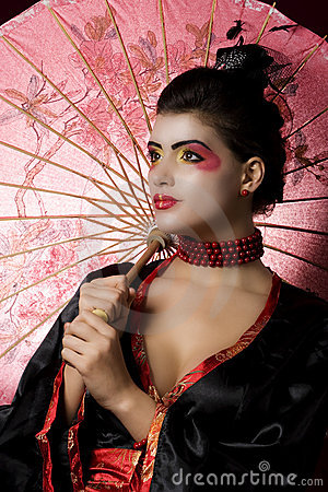 Sexy young geisha holding an umbrella