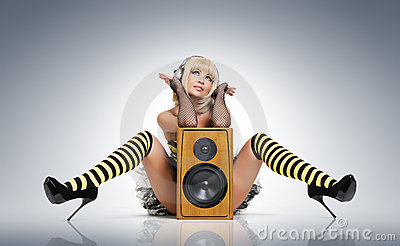 Sexy young girl in headphones with speaker