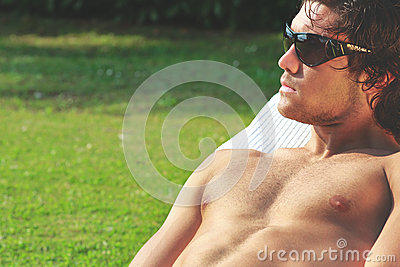 Sexy young man sunbath