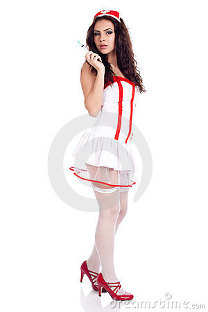 Sexy young nurse holding a syringe