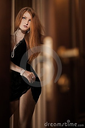 Free Sexy Young Redhead Woman Flirting Royalty Free Stock Photo - 22936135