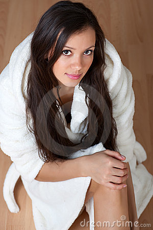 Sexy young woman in a bathrobe