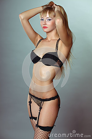 Sexy young woman in black lingerie