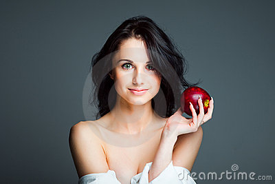 young woman with fresh red apple Stock Photo