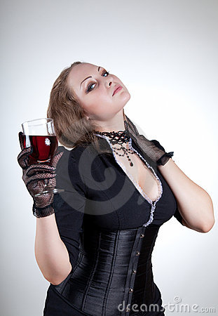 Sexy young woman with glass of red wine