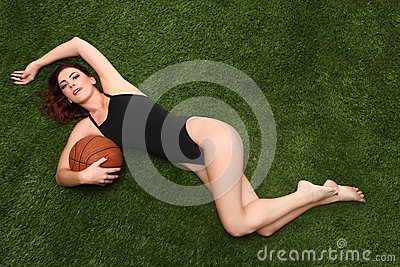 Sexy Young Woman Holding a Basketball