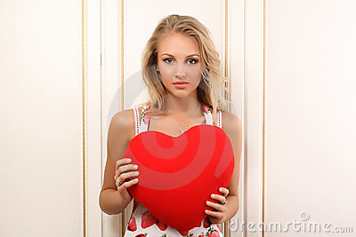 Sexy young woman holding heart