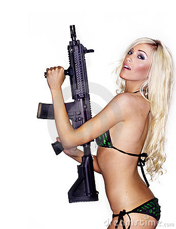 Sexy young woman holding weapon