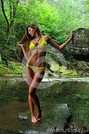 Free Sexy Young Woman Posing In Designer Bikini At Exotic Location Of Mountain River Royalty Free Stock Photography - 33310517