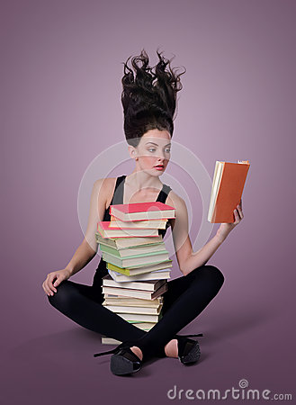 Sexy young woman reading a book, learning concept