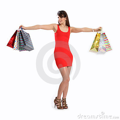 Sexy young woman in red dress with shopping bags