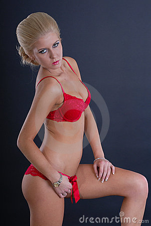 Sexy young woman in red lingerie