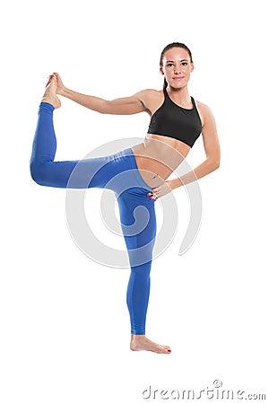 Sexy young yoga woman doing yogic exercise