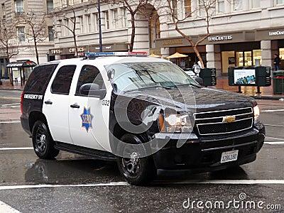 SFPD cop SUV rolls down market street Editorial Image