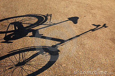 Shade of a bicycle on a asphalt.