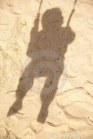 Shadow of child in swing