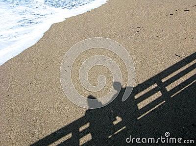 Shadow of couple on beach