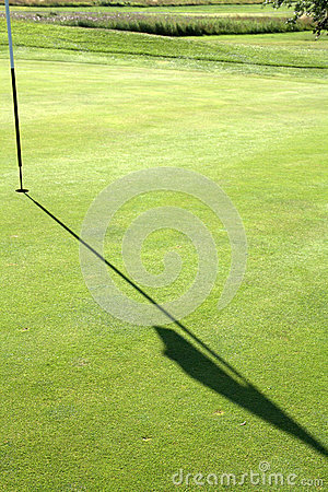 Shadow of flag on golf course