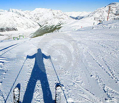 A shadow of ready to go downhill skier