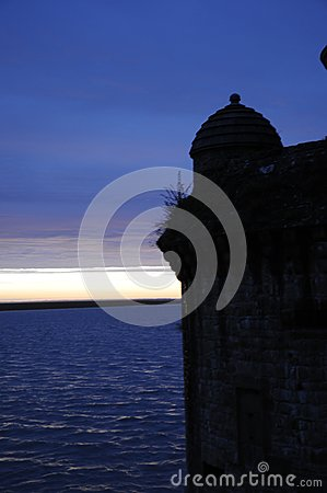 Shadow shape of old castle after sunset