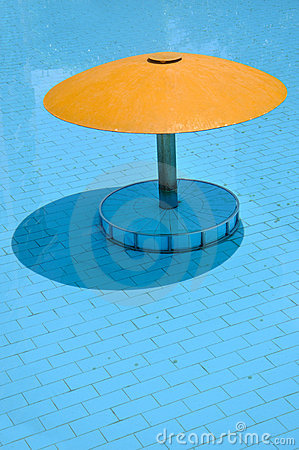 Shadow of sunshade in swimming pool