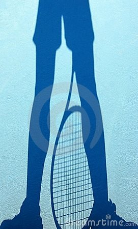 Shadow of a tennis player on a blue court