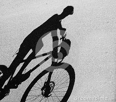 Shadowof a man with mountain bike