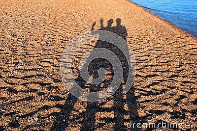 Shadows people on the beach