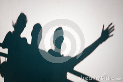 Shadows of people gesturing