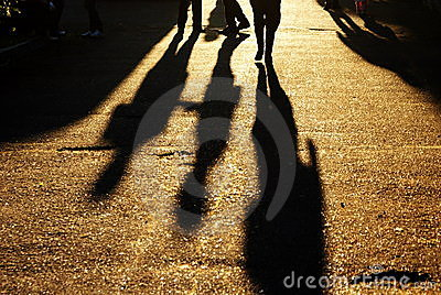 Shadows of people on road