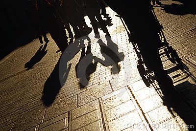 Shadows of people on street