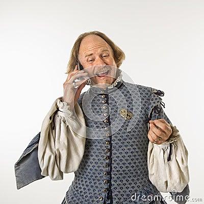 Shakespeare talking on phone.