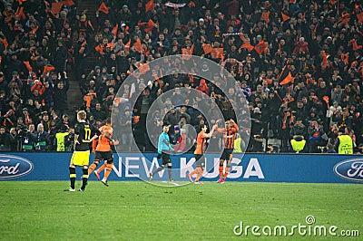 Shakhtar footballers celebrate scored goal against Borussia Dortmund Editorial Photo